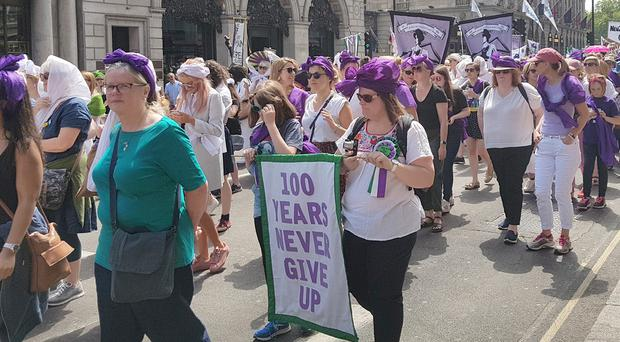 Thousands of people march through central London to celebrate 100 years since some women were granted the vote (Tess Delamare/PA)