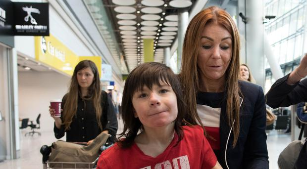 Charlotte Caldwell and her son Billy at Heathrow Airport (Stefan Rousseau/PA)