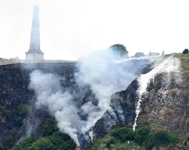 Firefighters tackle a gorse fire beside the Knockagh Monument in Carrickfergus yesterday