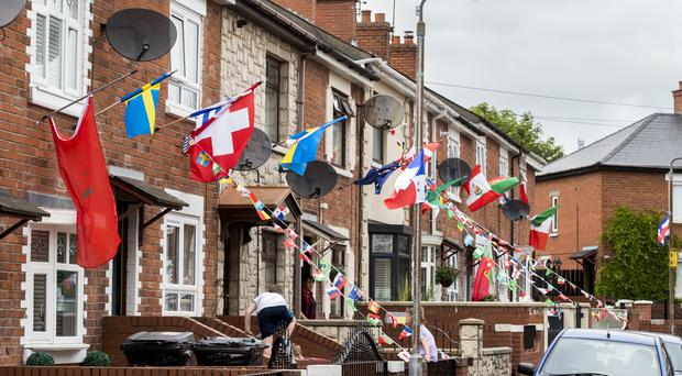 Whiterock Gardens in West Belfast where residents have gotten into World Cup fever (PA)