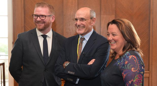 Professor Rafael Bengoa (centre) with Simon Hamilton and Paula Bradley during a briefing with the media and MLAs at Stormont