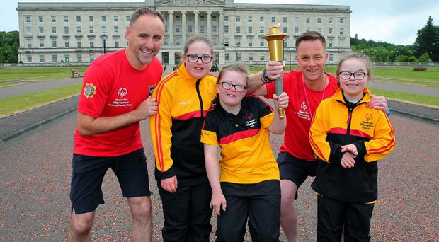 Michael Allen (left) and Andy Watson (right) with Team Ulster athletes, Kirsty Neill (16) from Belfast), Sophie Caron (13) from Donaghadee and Lucia Carrigan (10) from Belfast at Stormont