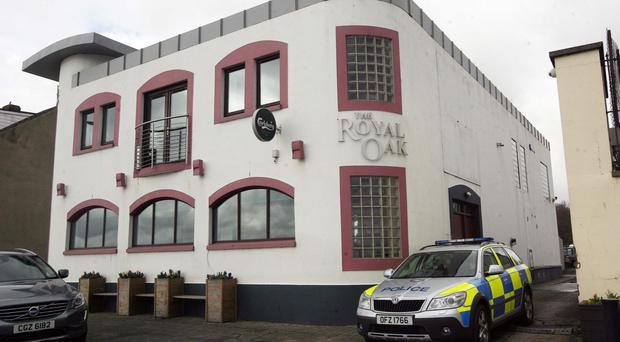 A police car outside the Royal Oak bar in Green Street, Carrickfergus, after the incident in March last year
