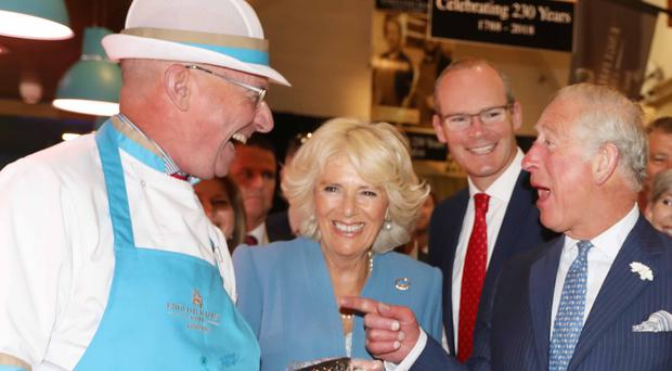 Charles and Camilla share a joke with fishmonger Pat O'Connell in the English Market in Cork yesterday