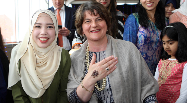 Arlene Foster shows off the henna design painted on to her hand by Syifaa Nabir
