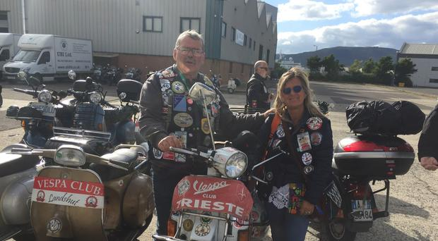 Mario Pecorari and Sandra Carozzi travelled from Trieste to Belfast for a Vespa festival. Michael McHugh/PA.