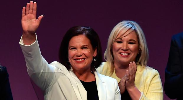 Sinn Fein president Mary Lou McDonald and vice president Michelle O'Neill are applauded by party members after McDonald's keynote speech during the Sinn Fein ard fheis at Waterfront Hall