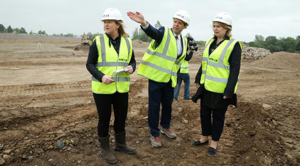 Karen Bradley at Strule Shared Education Campus project with John Smith, deputy secretary of the SSEC Programme, and Jennifer Morgan, Strule Construction director
