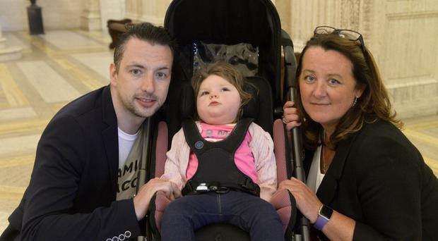 Robbie Emerson at Stormont with daughter Jorja and DUP Health spokesperson Paula Bradley