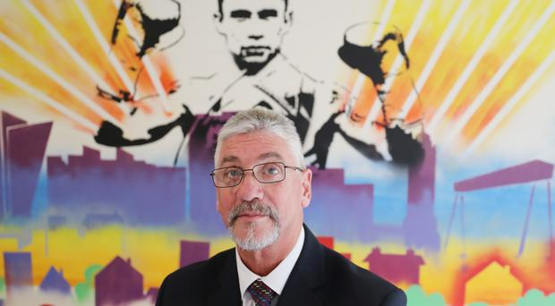 Brian Ingram Director of the Woodlands Juvenile Justice Centre near Bangor, beside a image of boxer Carl Frampton. Frampton is an inspiration for young people at the centre. Niall Carson/PA.
