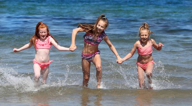 From left, sisters Keana and Keiva Keenan with Karlisha Wellstead, all from Belfast, enjoying the sunshine at Helen's Bay