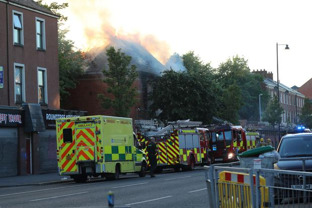 Fire crews deal with the incident at a former builder's yard on the corner of the lower Ormeau Road and University Avenue