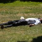 A man lies down in the sun in St James's Park, London (Yui Mok/PA)