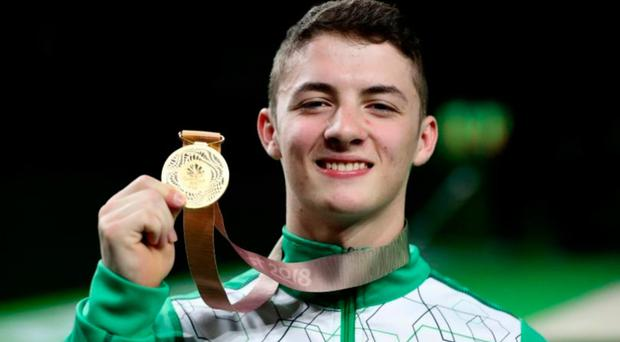 Rhys McClenaghan showing off his Commonwealth gold medal