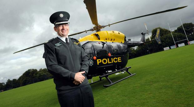 Drew Harris unveiling a new PSNI helicopter