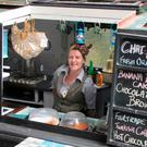Lorraine Fox at the serving hatch of the Sandwich Barge in Newry