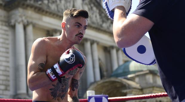 Boxer Tyrone McKenna during a workout session outside Belfast City Hall ahead of his fight against Jack Catterall