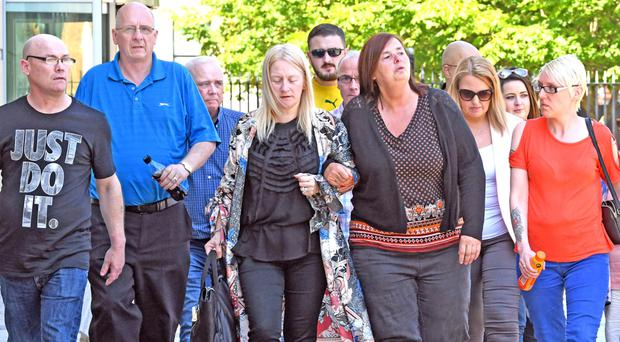 Anita's relatives leave Belfast Crown Court after yesterday's verdict