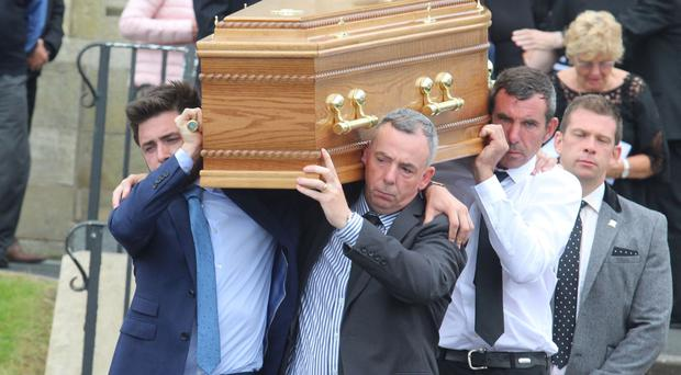 Family members of Edelle McGlade carry her coffin after her funeral at Star of the Sea Church in Portstewart on Sunday