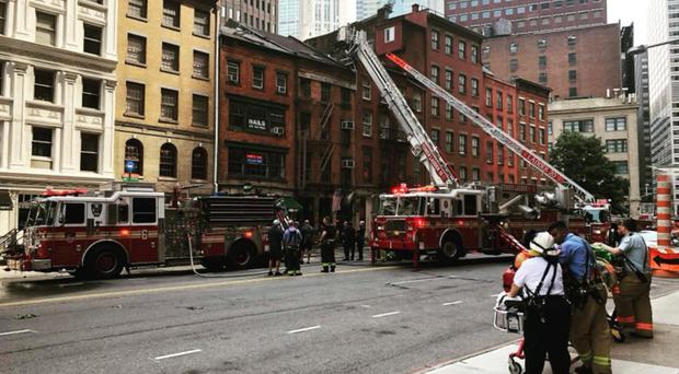 New York firefighters tackle the blaze at the world-renowned Dead Rabbit which is owned by Belfast businessmen Jack McGarry and Sean Muldoon