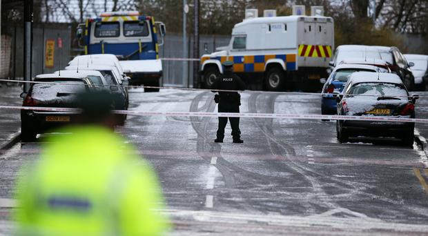 Police on Botanic Avenue, Belfast, after a man was found stabbed to death (Brian Lawless/PA)
