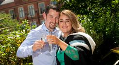 New graduate Stephanie Kirwan toasting her engagement with fiance Donal Begley