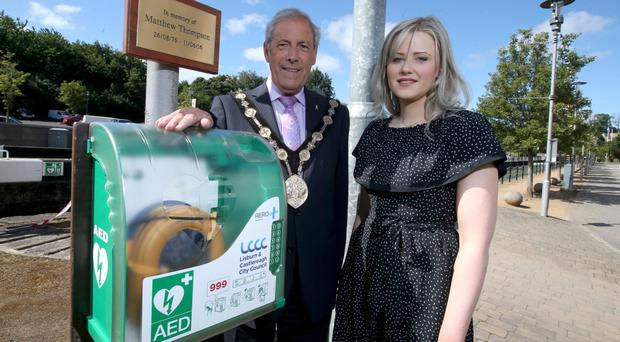 Uel Mackin and Lauren McCaughtry with the new defibrillator at Lagan Valley Island