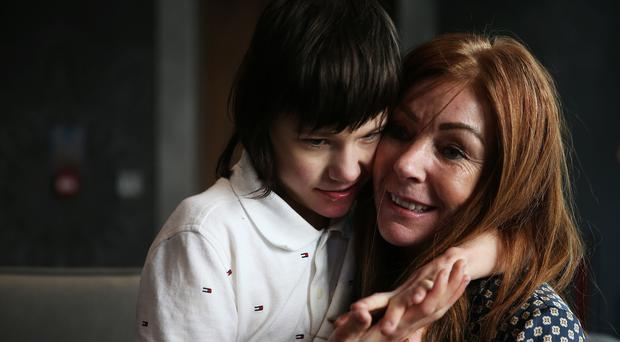 Billy Caldwell, who has a rare form of epilepsy, with his mother Charlotte (Brian Lawless/PA)