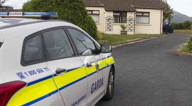 Gardai search a property in Omeath yesterday as part of an investigation into the disappearance of Saoirse Smyth