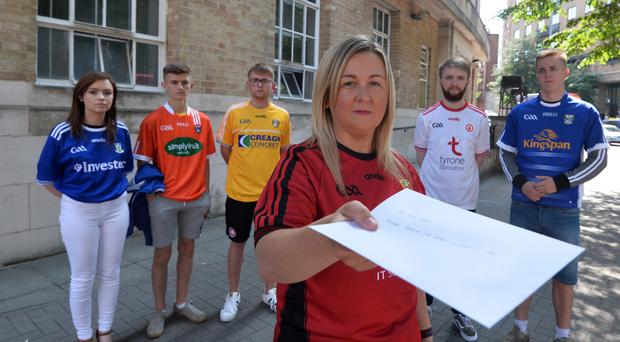 Sinn Fein MLA Sinead Ennis presented a letter to the BBC following a short protest in Belfast