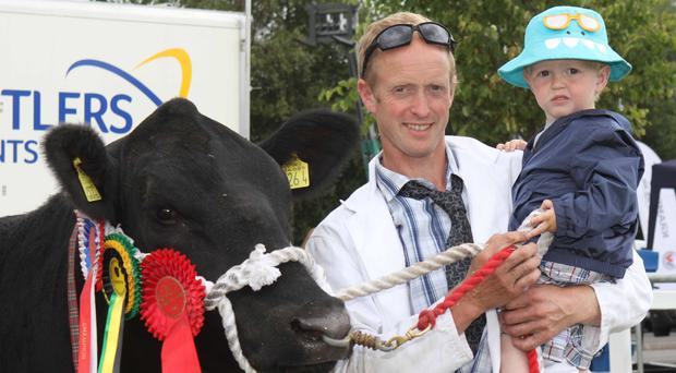 Moses Irwin and son Moses jnr from Fintona with their Aberdeen Angus champion at Omagh Show