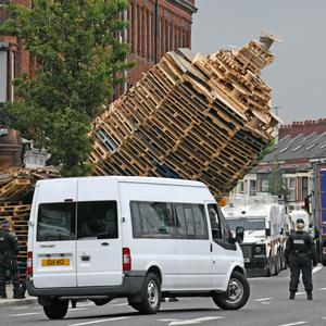 The Cluan Place bonfire in east Belfast which was toppled by a forklift truck before contractors removed the material