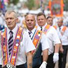 Orange order members take part in the annual Twelfth of July celebrations in Belfast city centre (Niall Carson/PA)