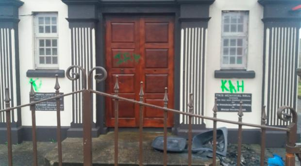Sectarian graffiti was also daubed on to the wall and door of the building