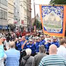 Thousands of people line the streets of Belfast to celebrate the Twelfth celebrations