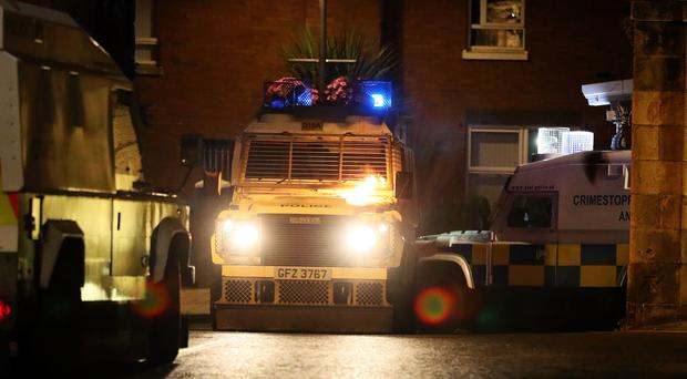 A police vehicle on Fahan street in Londonderry (Brian Lawless/PA)