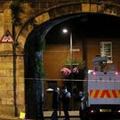 A police cordon on the city walls in Londonderry (Brian Lawless/PA)
