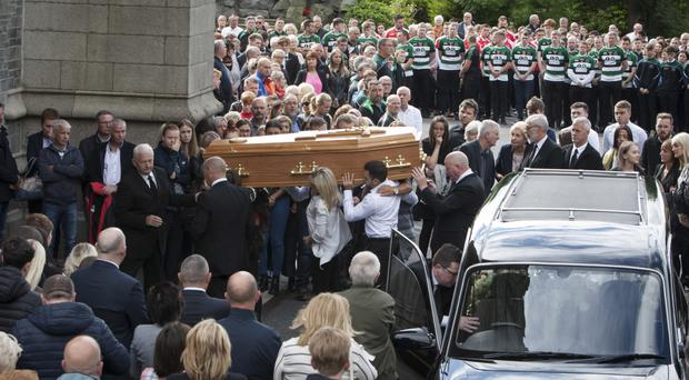 Aodhan O'Donnell's coffin is carried into St Eugene's Cathedral yesterday