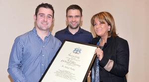 Louise Dunlop with her sons Michael and William receiving the Freeman of the Borough of Ballymoney