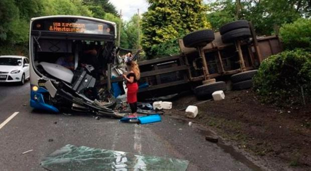The scene after the bus collided with a tractor