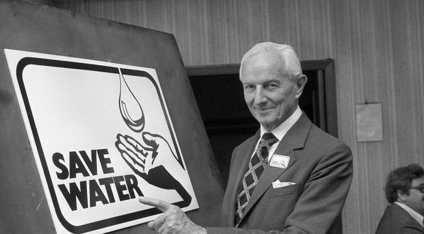Lord Nugent, chairman of the National Water Council, with the new Save Water symbol in 1976 (PA)