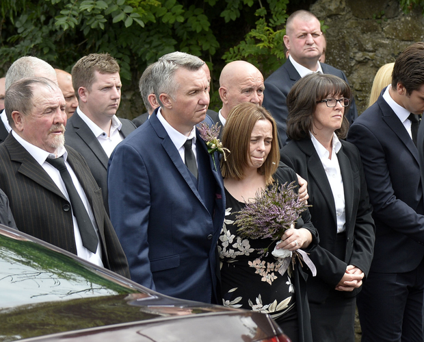 Family and friends at his funeral yesterday