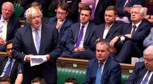 Former Foreign Secretary Boris Johnson speaks in the Commons yesterday as former Brexit Minister David Davis (right, back row) listens