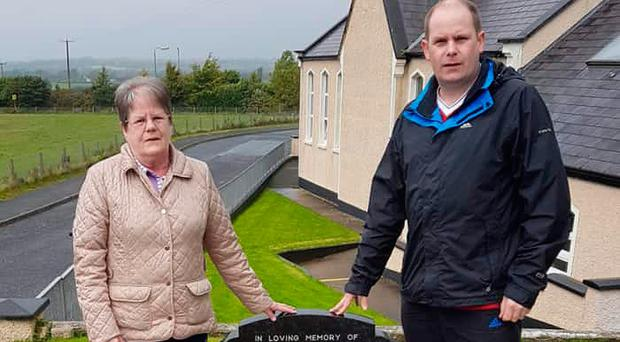 Mavis Clark and her son Scott at the family grave where Alan Jack is buried