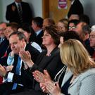 DUP leader Arlene Foster and deputy leader Nigel Dodds applaud