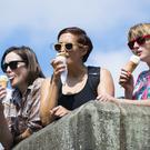 Young women enjoy an ice cream at Hebden Bridge, West Yorkshire, as hot weather continues across the UK.