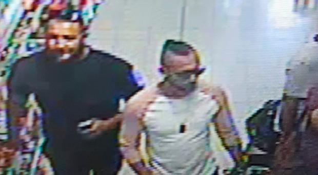 A CCTV image issued by West Mercia Police of three men