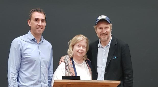 Liam Neeson (right) with Brian McCormick, manager of Seamus Heaney HomePlace, and Maebeth Fenton of Fenton PR