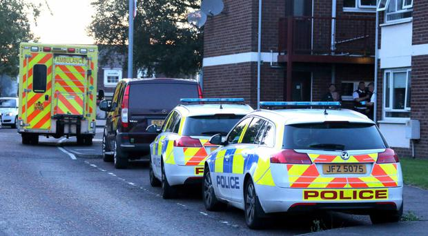 Police and paramedics at the scene of a serious incident in Trinity Drive, Ballymoney, last night