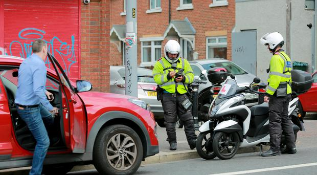 Enforcement officers dish out tickets in west Belfast. Pic Kevin Scott.